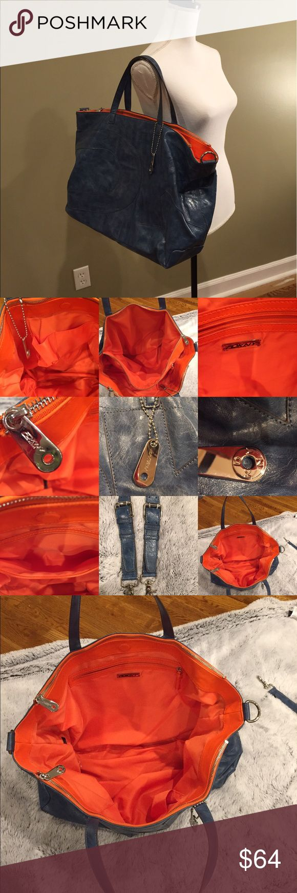 "Donna Karen blue /orange shoulder bag Beautiful blue leather bag is complimented with electric orange lining. 2 interior side zippers run the length of the purse sides with separate compartments. Interior zip pocket and 2 interior side pouch pockets. Magnetic closure. Additional body strap included. 6.5"" width base, 19"" length,13.5"" depth,47.5"" shoulder strap,16"" handles Donna Karen Bags Shoulder Bags"