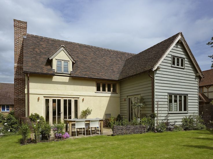 Border oak pearmain cottage rear view with painted for Weatherboard garage designs