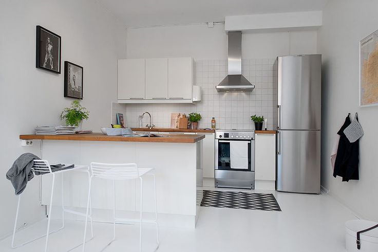 Znalezione obrazy dla zapytania salon z biala kuchnia lodowka wolnostojąca