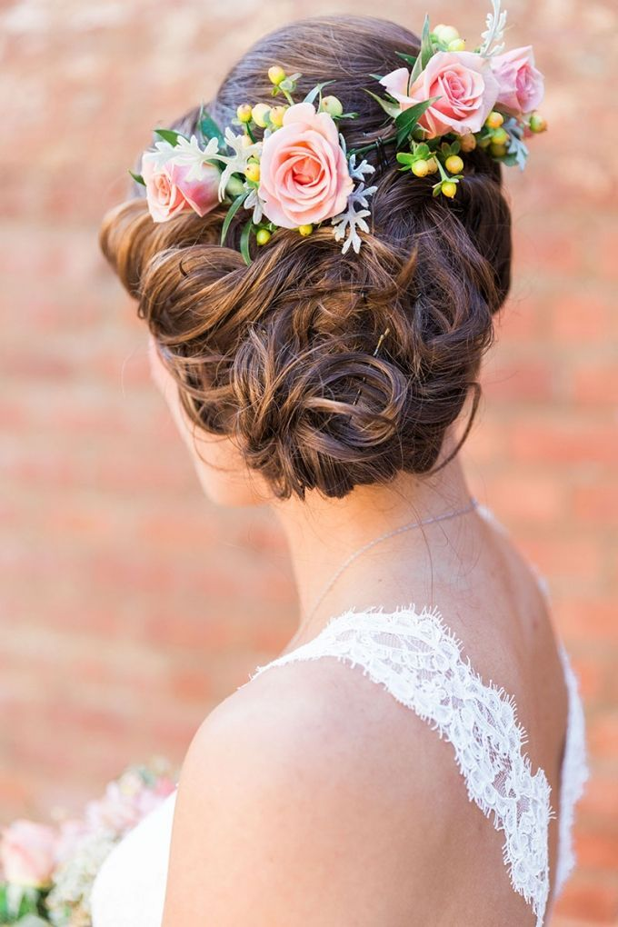 relaxed updo with flowers | Devon Donnahoo Photography | Glamour ...