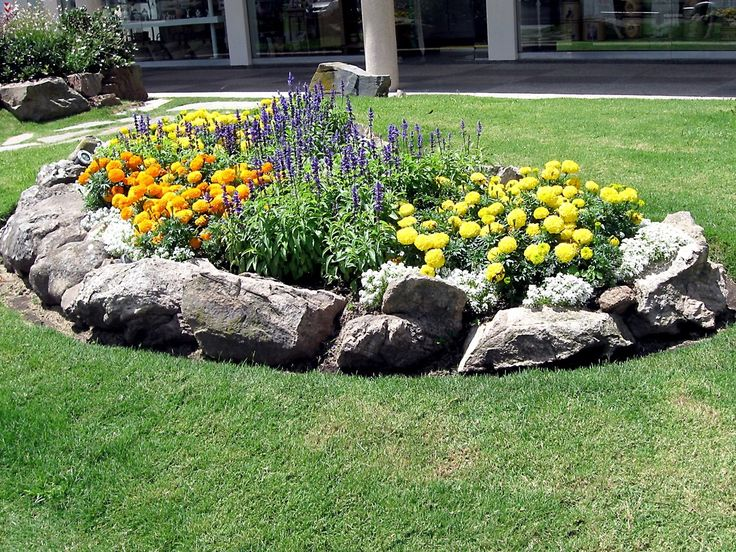 Flower bed with rock contour correct flower beds for for Large flower bed design ideas