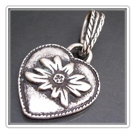 Solid edelweiss heart pendant.