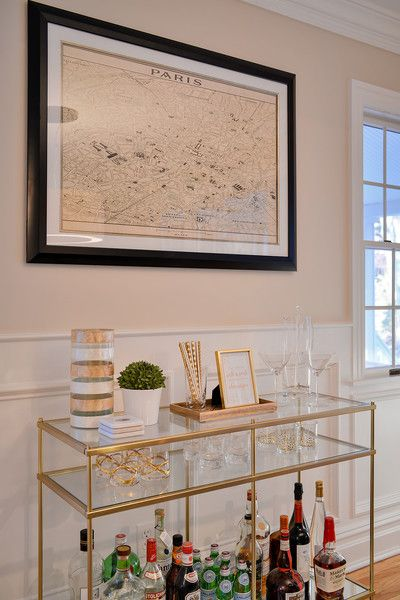Contemporary Bar: Contemporary gold bar cart below a map of Paris..