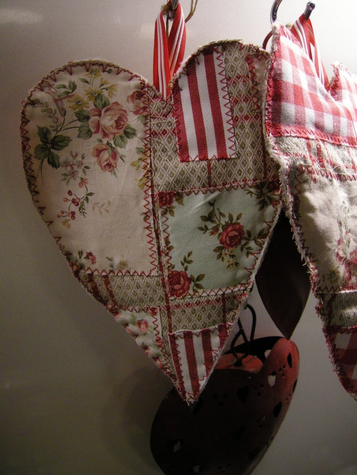 Patchwork hearts...for some reason when I was little, I always wanted a handmade patchwork heart-shaped pillow..