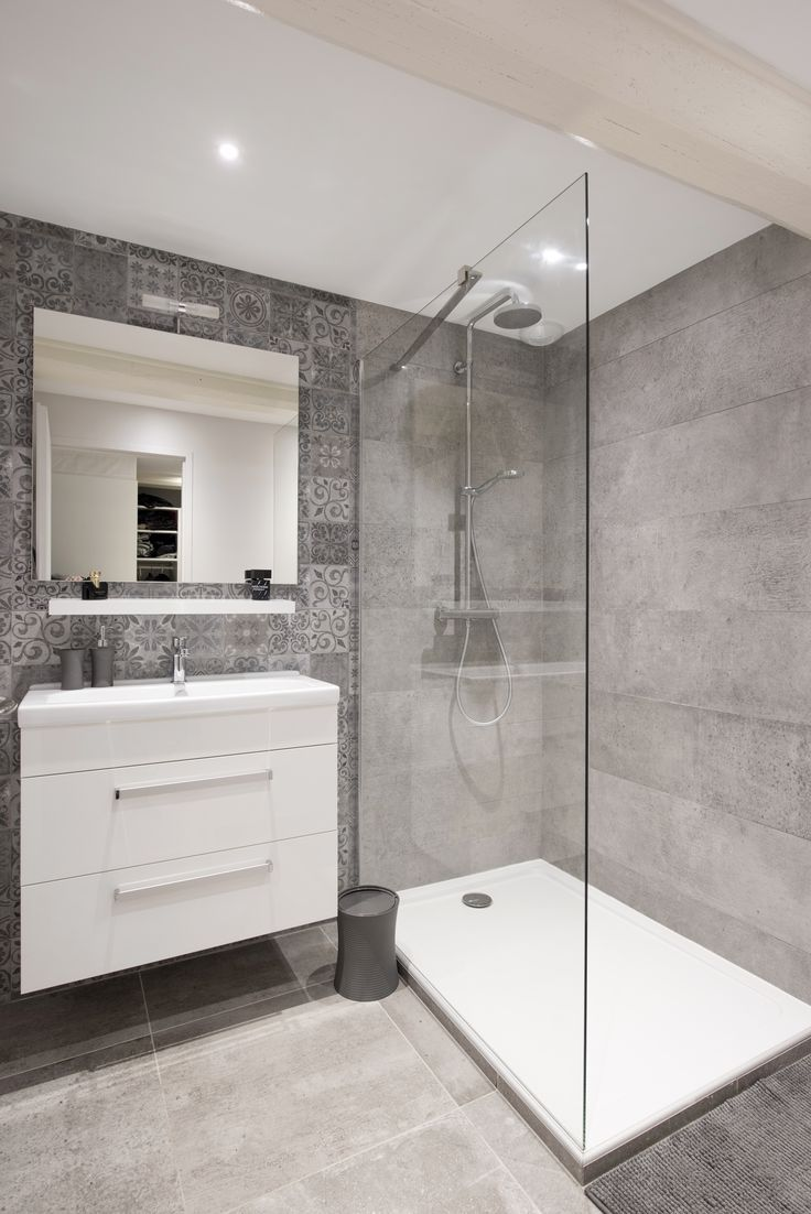 Basement bath/Guest bathroom with wood grain tile floor, subway tile in the  shower and white countertop