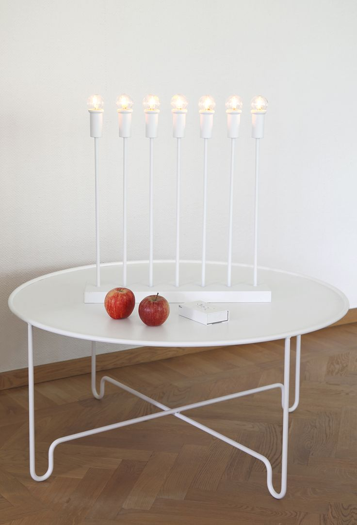 Lighting for Christmas. Straight in White, design Katarina Dahl . You may find it also in brass.