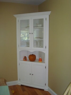 Would love to have a corner china cabinet this style. Color more of an rustic antique white.