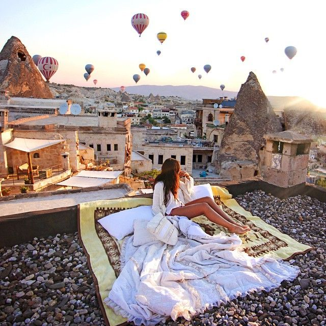 Breathtaking! Nuptial bed and hot-air balloons above the roofs of Cappadocia, Turkey - by who what wear