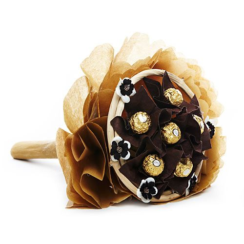 "Add some shimmer with sweetness on any occasion by gifting your loved ones with our golden bouquet of 6 Ferrero Rocher Chocolates enclosed in a brown paper flowers with a wooden ring around it in a bouquet made of golden and fawn colored wrapping paper.""FNP gifts are delivered by third party courier and which can be delivered within 3 to 4 working days. http://www.fnp.com/flowers/golden-delight/--clI_2-pI_35836.html"