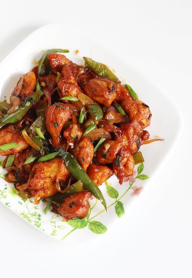 Garnished popular indo chinese dry chilli chicken is ready