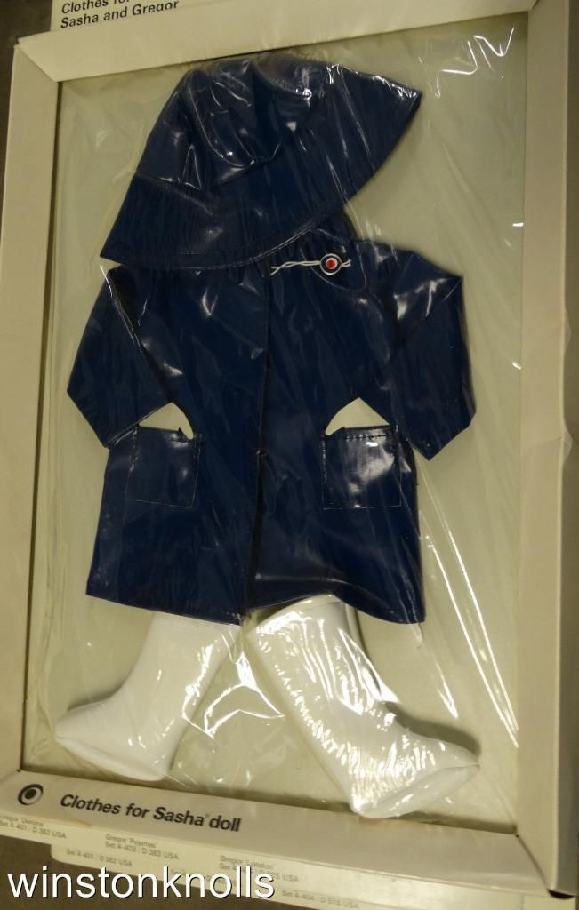 Blue raincoat with sou'wester and white boots still in box.