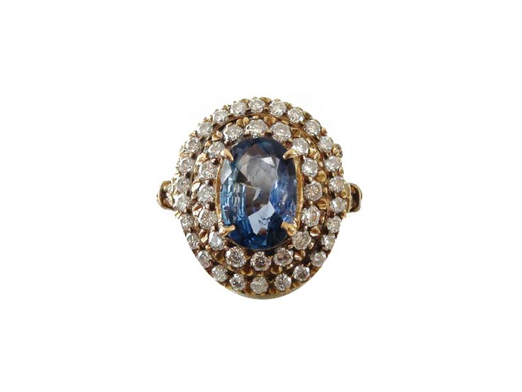 Blue Sapphire and diamond ring in gold, from Karni Jewellers.