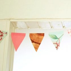 Make a colorful bunting with wallpaper samples! Step by step instructions on By Wilma