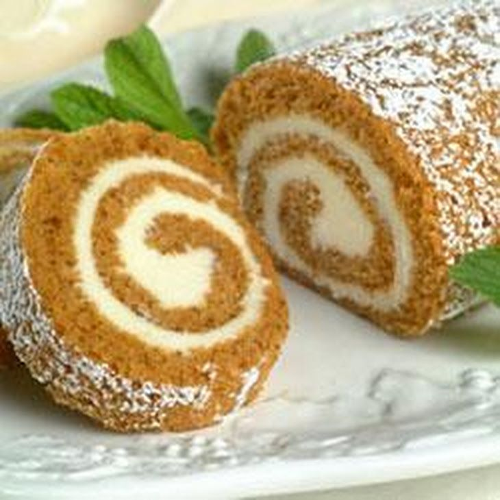Libby's® Pumpkin Roll with Cream Cheese Filling Recipe Desserts with powdered sugar, all-purpose flour, baking powder, baking soda, ground cinnamon, ground cloves, salt, large eggs, granulated sugar, pumpkin, walnuts, cream cheese, powdered sugar, butter, vanilla extract, powdered sugar