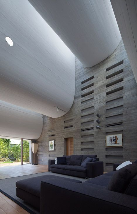 A curving roofline enhances acoustics inside this Japanese house.