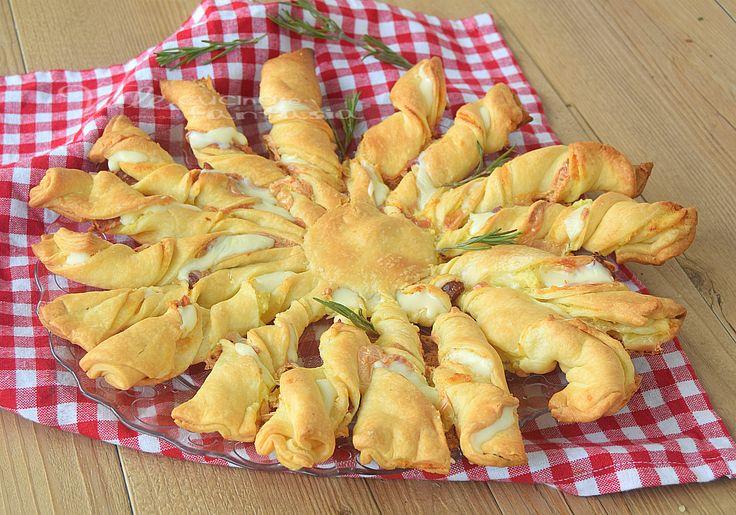 Girasole di sfoglia con patate salame e formaggio, ideale per antipasto,aperitivo e cene velocissime, si prepara in poco tempo tempo ed è molto sfizioso.