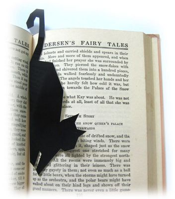 "Great idea! - ""cat bookmark""  I just made myself one, super easy with good black construction paper, pensil, and scissors, so fun."