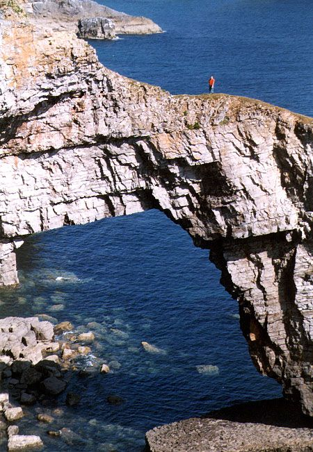 NABS member Ray Millar stands atop the Green Bridge of Wales, probably the most spectacular arch in the United Kingdom, with a height of approximately 80 feet. It is situated off the Pembrokeshire coast of southwest Wales. Photo courtesy of Ray Millar.