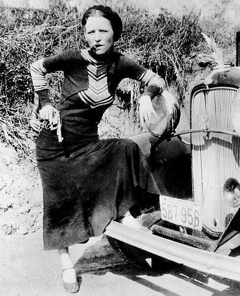 Bonnie Elizabeth Parker (October 1, 1910 - May 23, 1934) of 'Bonnie and Clyde'. Posing with a Ford V-8 B-400 convertible sedan, 1932.