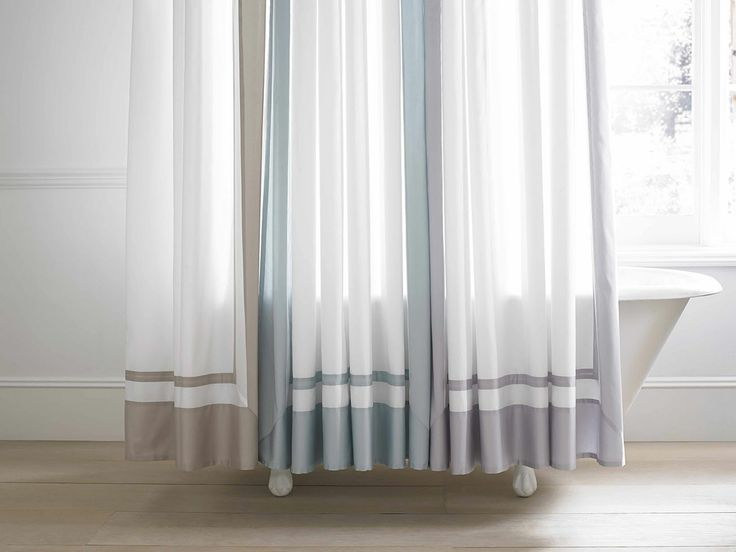 Create the look and feel of a hotel worthy bathroom with for Shower curtain savers