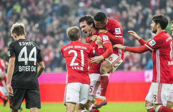 Mats Hummels Photos Photos - Mats Hummels  (M) of FC Bayern Muenchen and his team celebrate the 2:1 goal during the Bundesliga match between Bayern Muenchen and Bayer 04 Leverkusen at Allianz Arena on November 26, 2016 in Munich, Germany. - Bayern Muenchen v Bayer 04 Leverkusen - Bundesliga