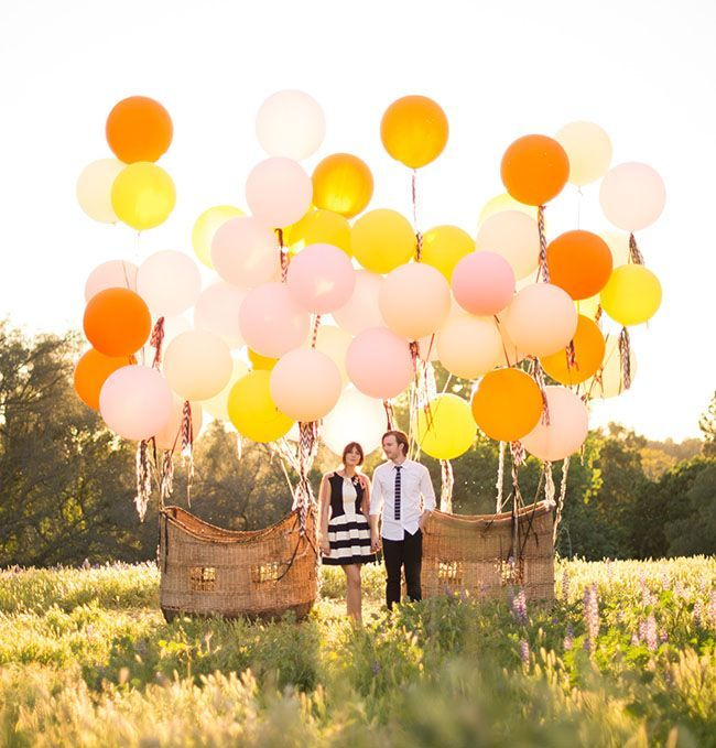 Giant balloon basket for engagement photos. Image via: http://greenweddingshoes.com/vintage-hot-air-balloon-wedding-inspiration/