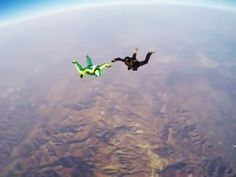 In this stunt, Luke Aikins jumps from a plane and lands in a net without using a parachute.  Here are some physics questions and answers.