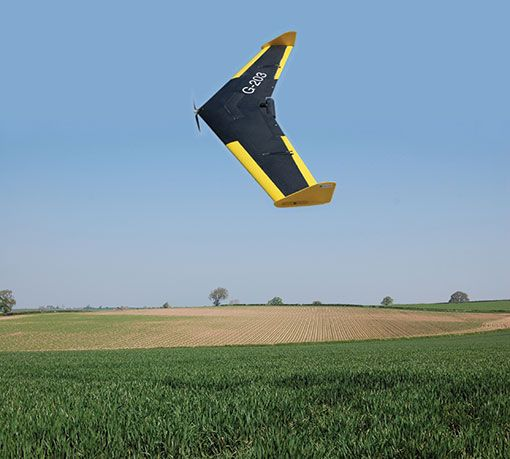 Fixed wing Drone, UAV, collecting image data over farm fields. Interpretation of this data can aid farm management and costs efficiency.