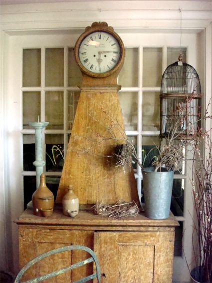 Stunning piece of antique furniture. Love the clock combined with cabinet.