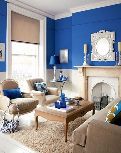 Royal blue tan white living room room design for Blue living room decor ideas