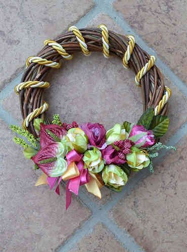 SMALL SIZED WREATH – Gold - PatriziaB.com  Wonderful handcrafted wreath, woven from wicker, embellished with a refined decoration of rosettes, berries and satin ribbons