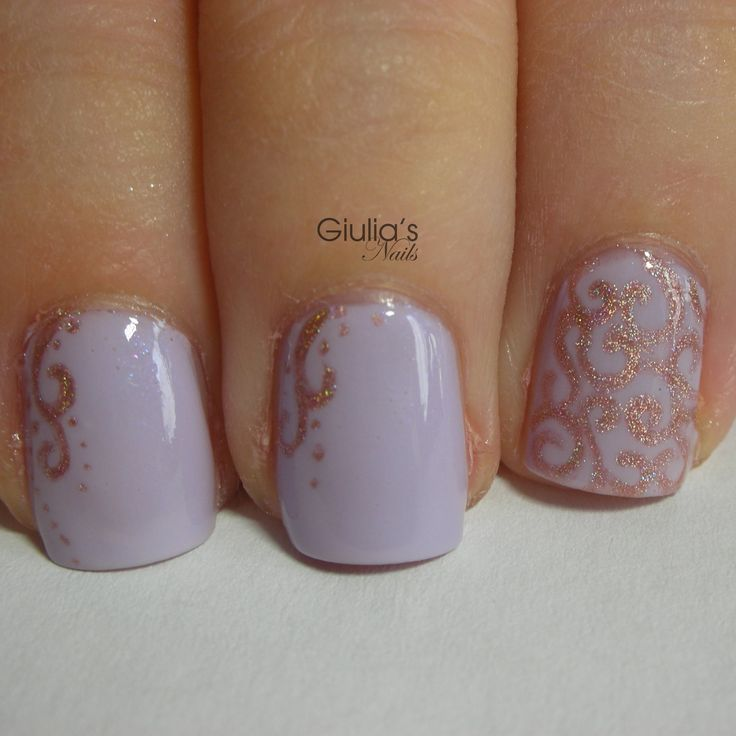 over a light lilac polish decorate your nails with a pretty arabesque pattern for an unforgettable manicure