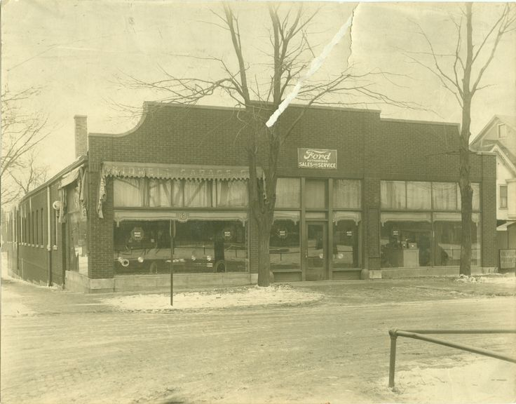 994 WARREN – KIDWELL FORD DEALERSHIP AND GARAGE  now SCARLETTI'S ITALIAN KITCHEN -This photo taken C 1920 -This building was later owned first by Kestner Motors and then Madden Ford -Madden Ford located here only a short time before moving to 1230 Ogden -1966 Madden opened at current location, 2150 Ogden, now  Packey Webb Ford