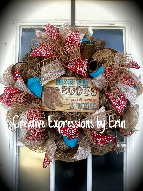 This western cowboy wreath is made on a burlap mesh base, decorated with turquoise and brown burlap ribbon, brown paper mesh, burlap lace