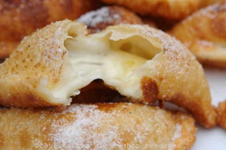 Recipe for empanadas de viento or fried cheese empanadas, these delicious traditional Ecuadorian empanadas are filled with cheese, fried until crispy, and served sprinkled with sugar.