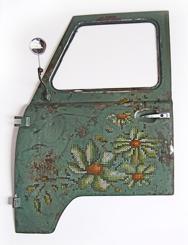Severija Incirauskaite-Kriauneviciene has made these gorgeous embroidered car doors by drilling holes and sewing through them.