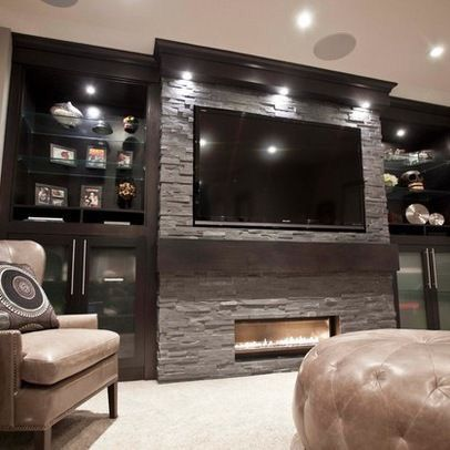 #living: Larger fireplace; shelves are thick wood with down lighting under each; better mantle
