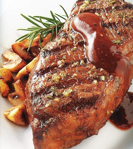 Oven baked rump steak with rosemary sauce. Beef steak with dry red wine and rosemary cooked in halogen (turbo) oven.Cooked without any oil.Very healthy and delicious!