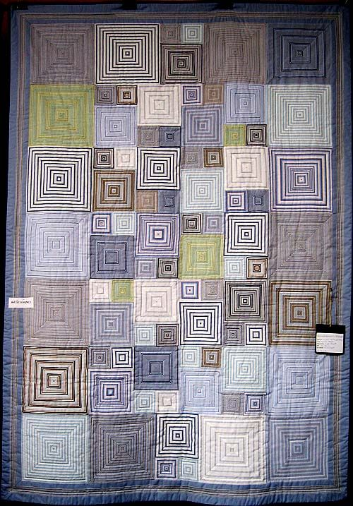 I love looking for the assembly lines in this quilt, and how ordinary shirting stripes are transformed from conservative to lively with right angles.  Kaffe Fassett quilt, pinned from a Danish site whose caption I can't read.  Not clear if this is Kaffe's image, or a quilt made to that pattern.  http://www.kludekoner.dk/forside.php?ssprog=dansk&=4898#