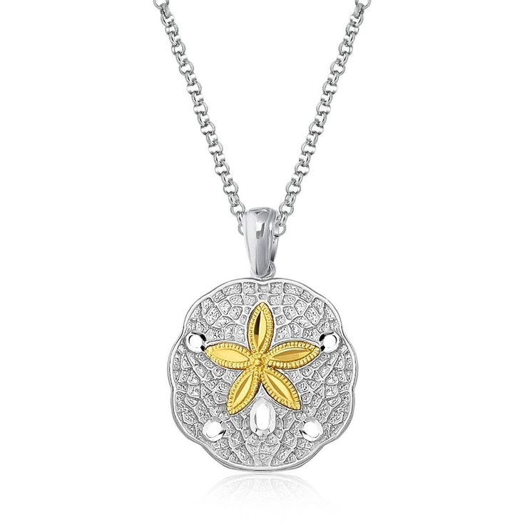A wonderfully detailed sand dollar leaps to the eye as the warmth of 14K yellow gold stands out against the rich textures of the silver surface. This delightful