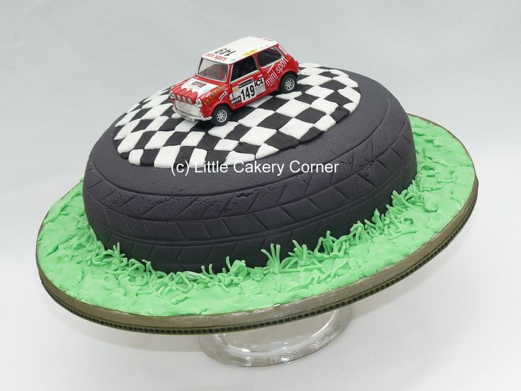 A fab cake for all those difficult-to-make-for men!  This would be great for a car enthusiast and for any age of birthday - 18th, 21st, 60th, retirement - or even a litle boy's birthday.  It features a tyre lying on the grass, a chequered flag topper and model toy mini.  Any model car could be used, according to the lucky recipient's favourites.