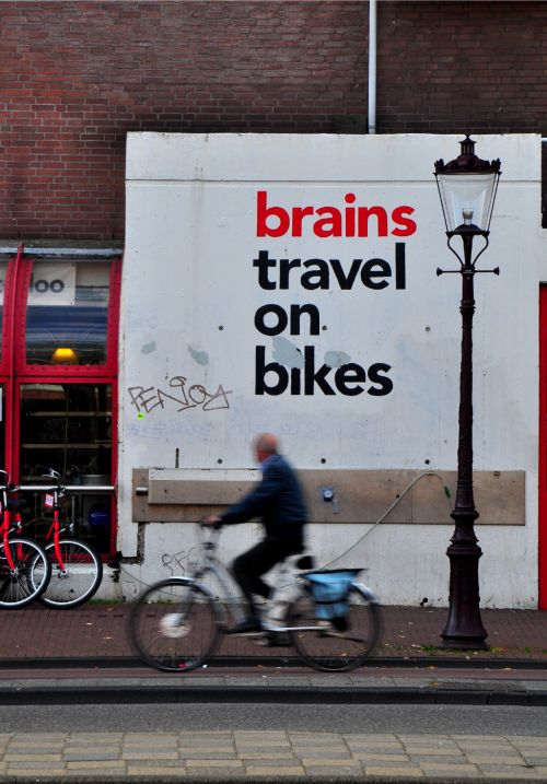 An awesome message on a wall in Amsterdam, the bike and cycling capital of the world.  Those Dutch must be SMART!  Photo from Bringing Beauty Home. Sara Lynne Moffatt