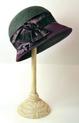 """Grey Flannel and Plum Cloche-    The hand-dyed, vintage silk velvet band in variegated hues of violet encompasses a lovely classic. Arrives in a keepsake hatbox."""
