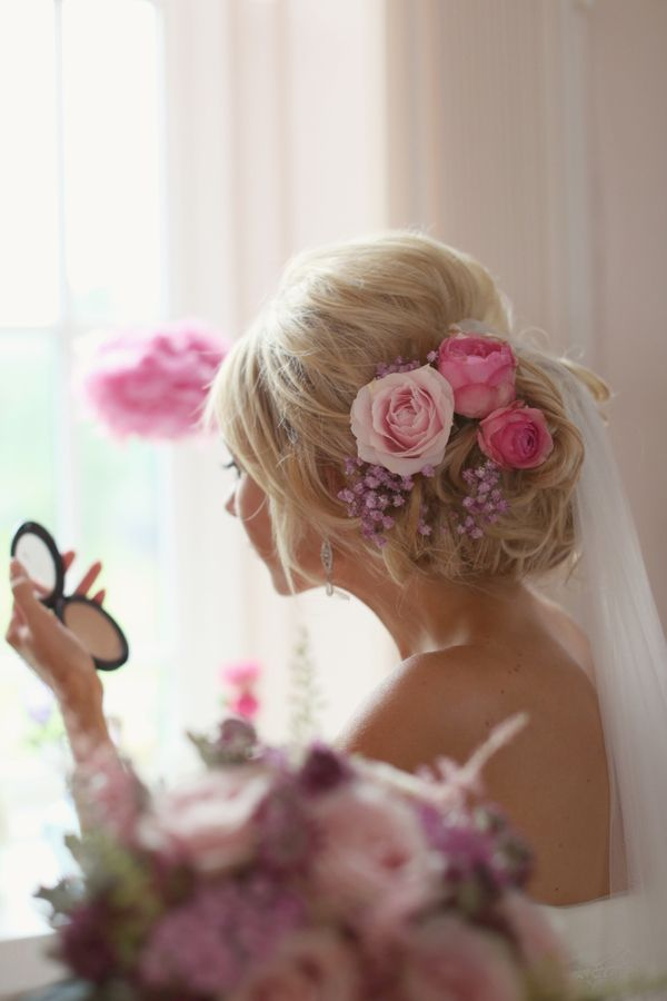 Real pink flowers in her hair, from 'A Pastel Pink and Romantic Homemade, Humanist Wedding'  http://www.craigsandersphotography.co.uk/