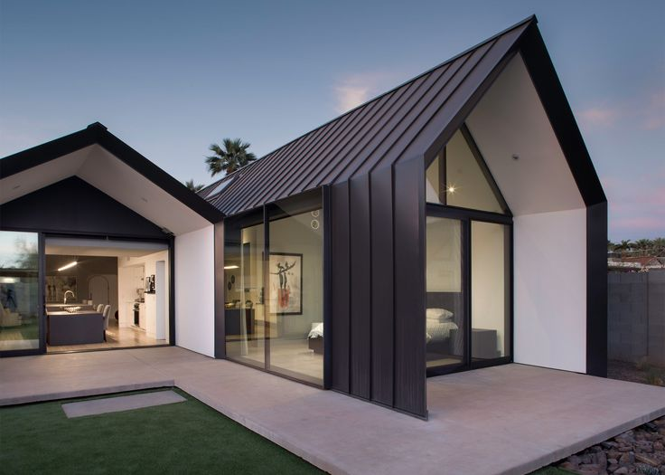 US firm Chen + Suchart Studio has renovated and expanded a 1930s dwelling in Phoenix, Arizona, adding a metal-clad volume with a window wall and a pointy roof.