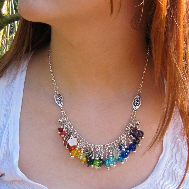 Rainbow charm necklace, umbrella, sun. $28.00, via Etsy.- Goddess Jewels UK