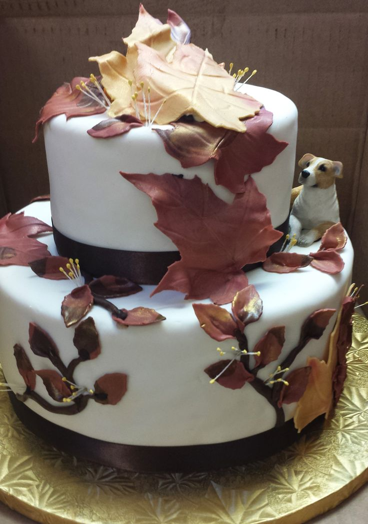 A Gorgeous Fall Wedding Cake Featuring A Proud Little