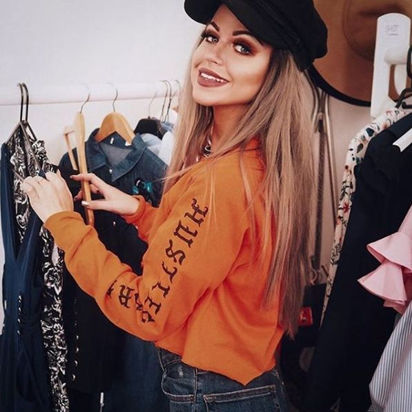 Stand out in the crowd with this super vibrant orange top. Hustle hard old english script down each sleeve for extra sass.