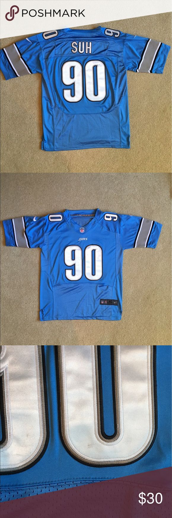 """Nike Ndamukong Suh Detroit Lions Jersey. (40) Nike Ndamukong Suh Detroit Lions Jersey. Size 40. Check measurements for an accurate fit. Couple marks throughout as pictured. Overall excellent condition! Measurements. Chest: 23.5"""" Collar Down: 23.5"""" Nike Shirts Tees - Short Sleeve"""