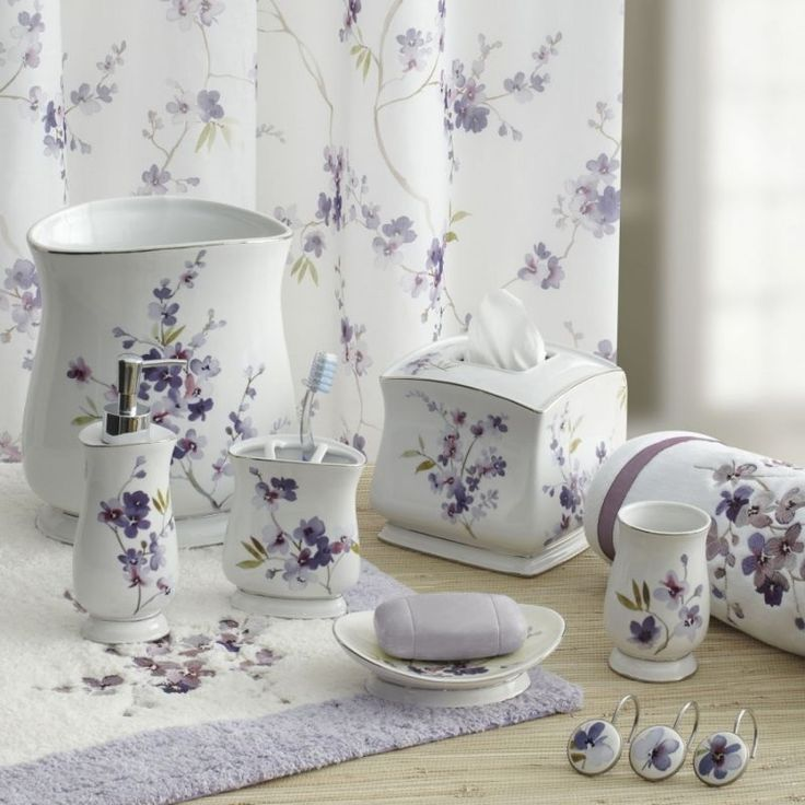 delicate purple flowers adorn a white backdrop in this classically beautiful bathroom ensemble coordinate these bath accessories with the pergola bath